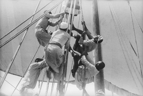 Sailors climbing up to the halyard blocks_3115297927_m