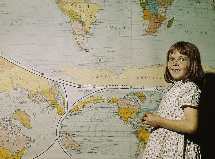 2179120975_ec91957b20_o----girl with map-loc-crop742