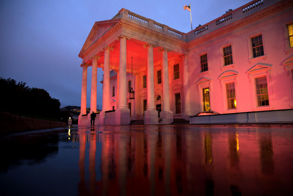 The North Portico of the White House is illuminated pink in honor of Breast Cancer Awareness Month, Oct. 15, 2014. (Official White House Photo by Chuck Kennedy)
