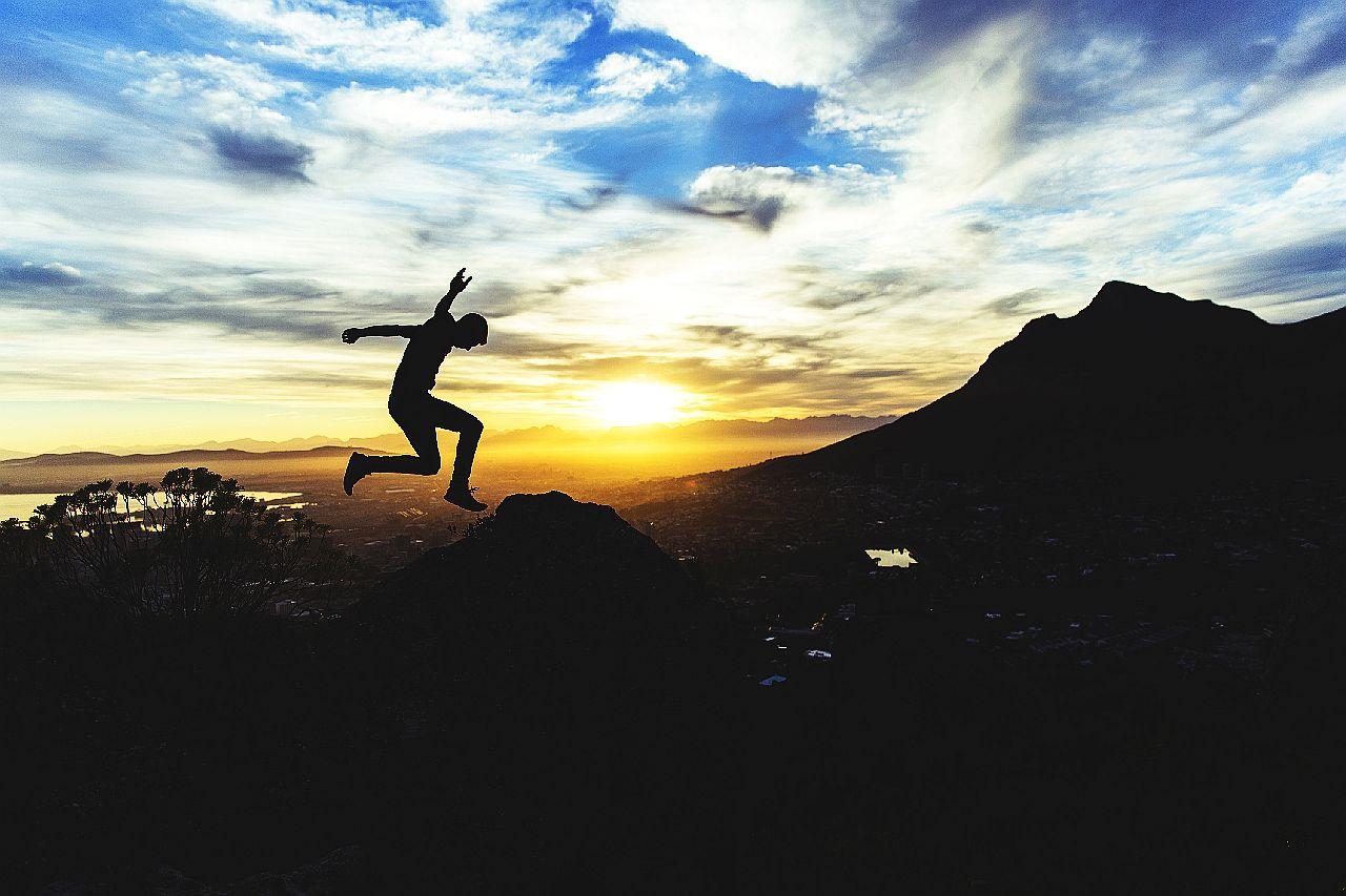 s00f6-w_oq8-joshua-earle-man-jump-sunrise-sunset-mountain-unsplash-1280w