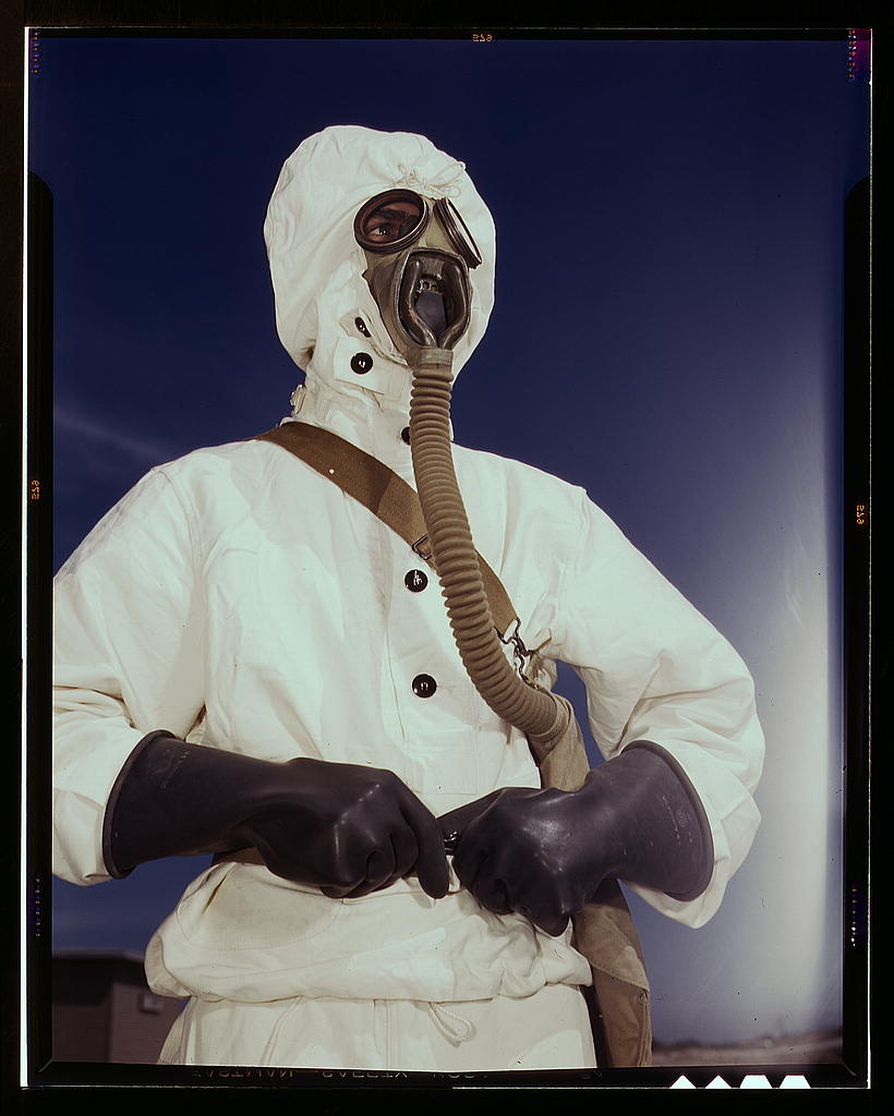 LOC - 1930s -1940s - Sailor at the Naval Air Base wears the new type protective clothing and gas mask designed for use in 2179222002