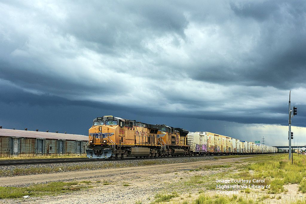 proc-001_A freight train colorfully adorned with grafitti approaches Cheyenne, Wyoming